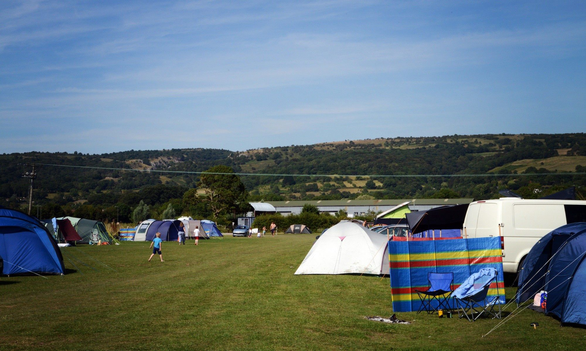 A live-and-let-live place where all are welcome. Kids can be kids, campfires are encouraged, music is not a problem and people feel free to wander round making new friends.
