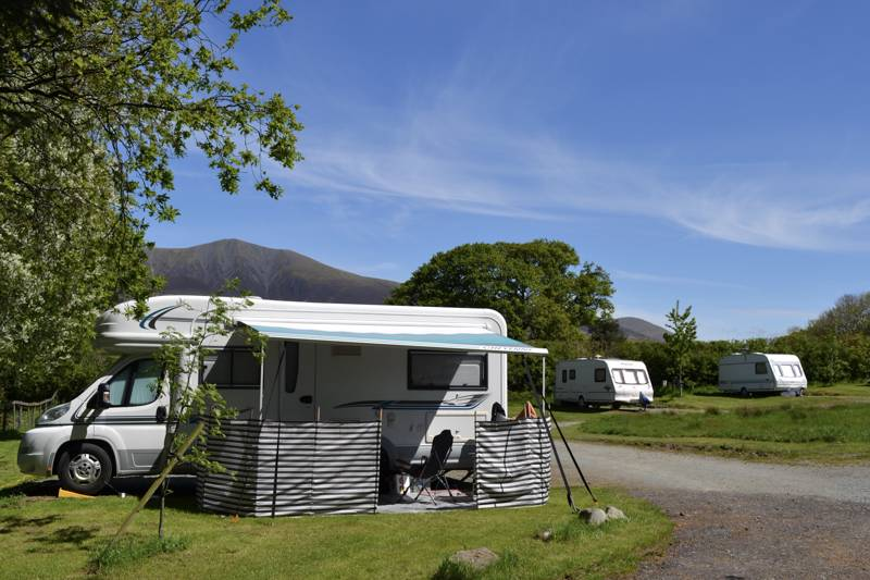 Lanefoot Farm Campsite - motorhome with sun canopy and caravans on the Open Field