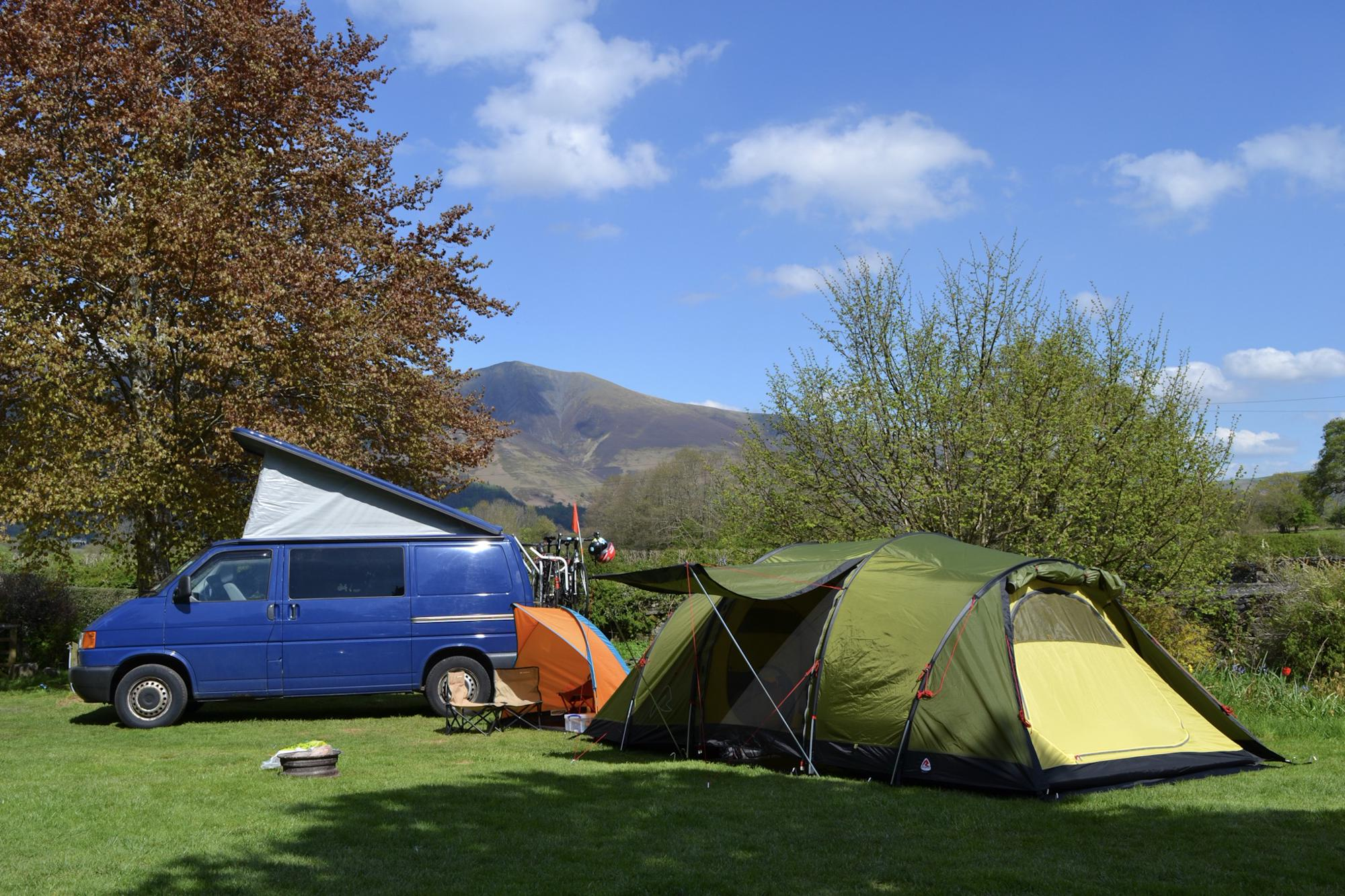 Lanefoot Farm Campsite - blue VW campervan, orange pup tent and green tent with view of Skiddaw