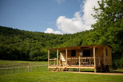 Western glamping in the Dorset countryside with bespoke pioneer cabins and safari tents nestled in the foothills of Shillingstone Hill boasting far reaching views across the Blackmore Vale.