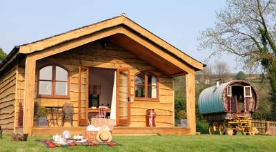 Located on peaceful hills of South Shropshire lies Hill Side Gypsy Caravan Holidays, a small glamping setup with a tranquil atmosphere and uninterrupted countryside views.