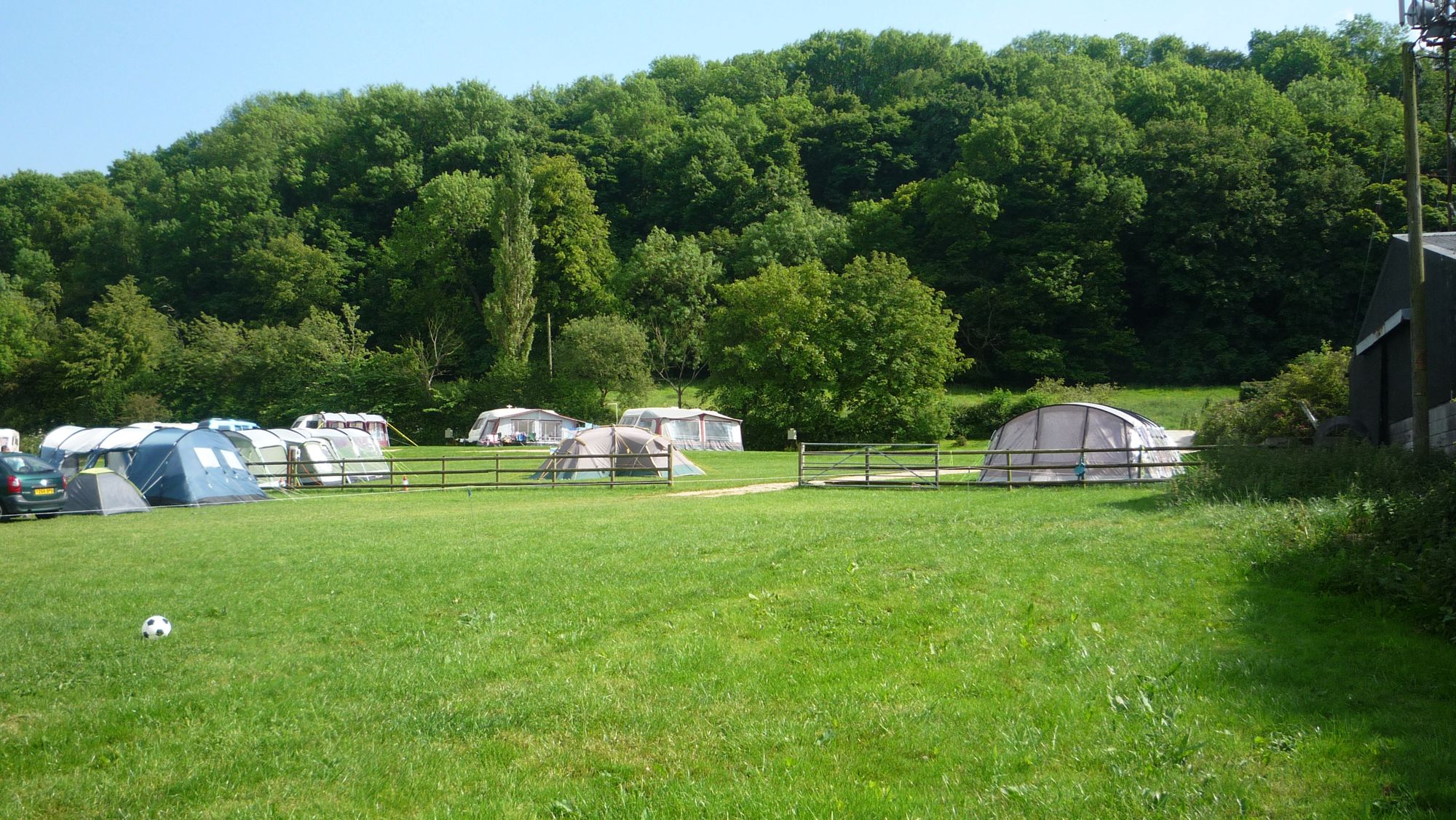 A tiny farm campsite in Staffordshire with exceptional views of the Peak District and Weaver Hills in the north and shelter from Marchington Cliff in the south.