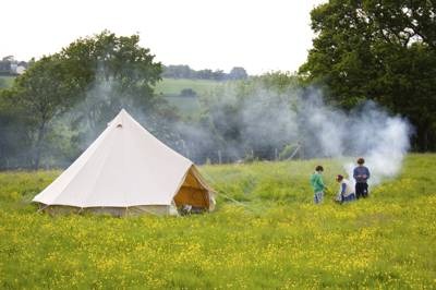 A convivial rural campsite with 15 pitches in a hilltop grassy meadow in the Garden of England. Play in the wildflowers, cook atop your campfire, or just plain chill.