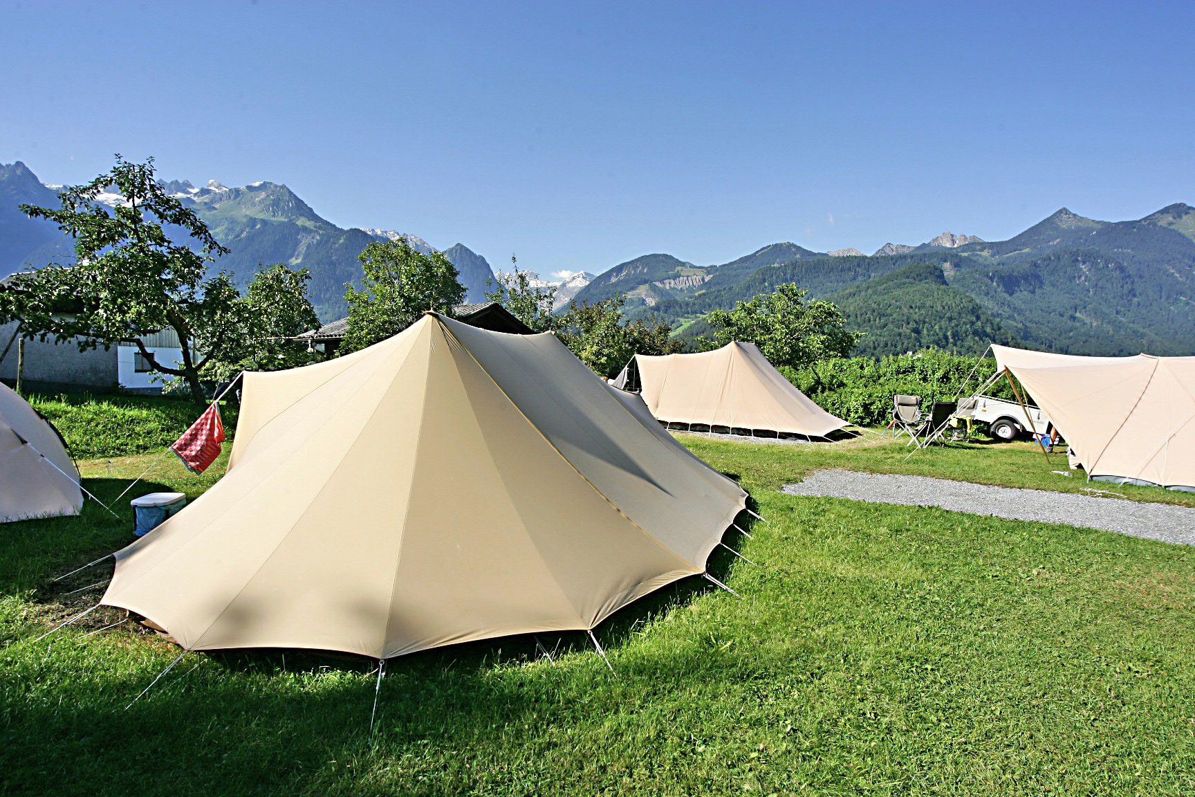 Meticulous and atmospheric campsite ringed by the peaks of Vorarlberg's mountain ranges.
