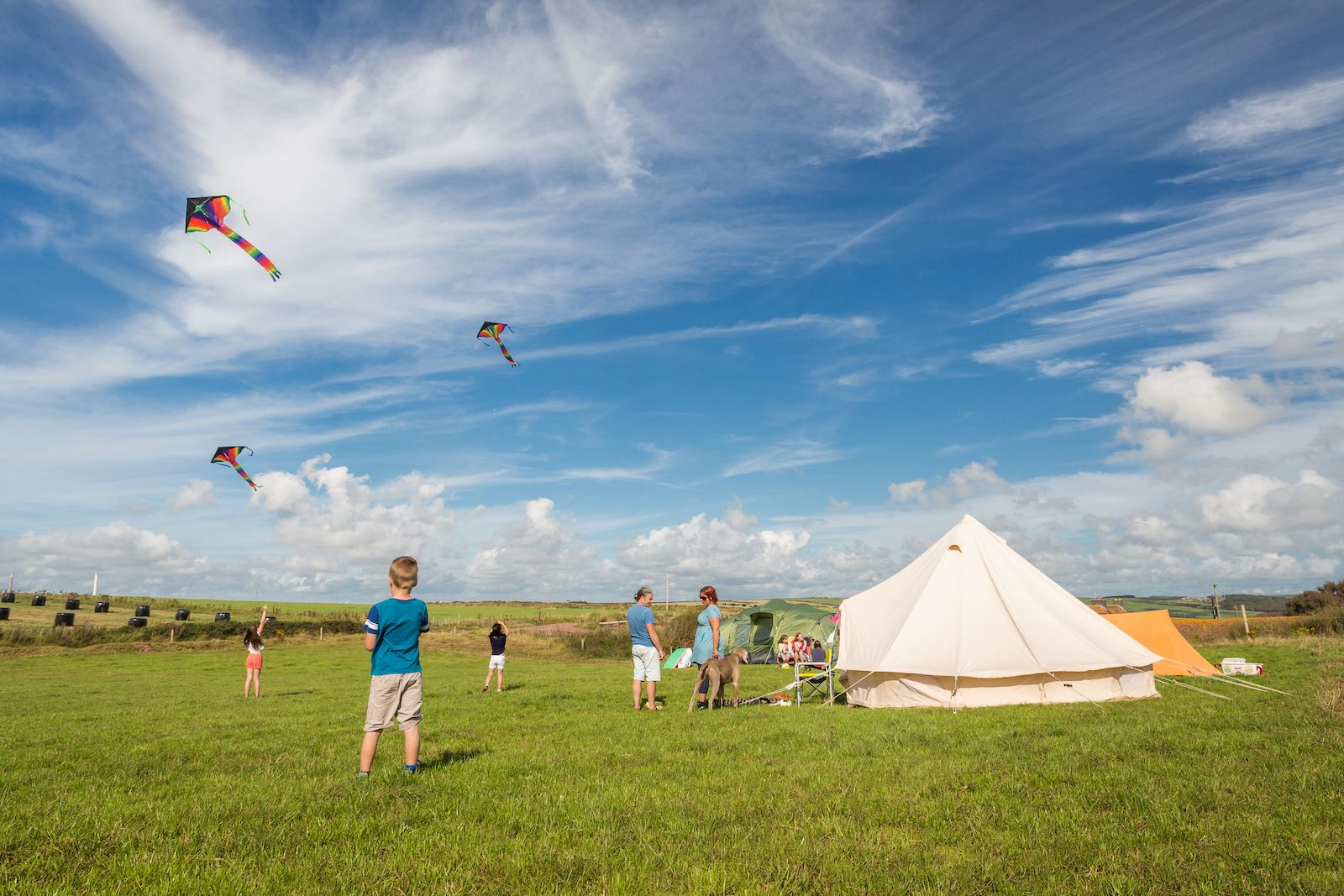 A National Trust campsite in Pembrokeshire in a simple, rustic setting with facilities including a heated toilet and shower block, a wet weather barn, communal areas and loads of outdoor space.