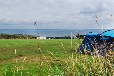 A big but intimate site with 180 degree views of a cracking coastline.
