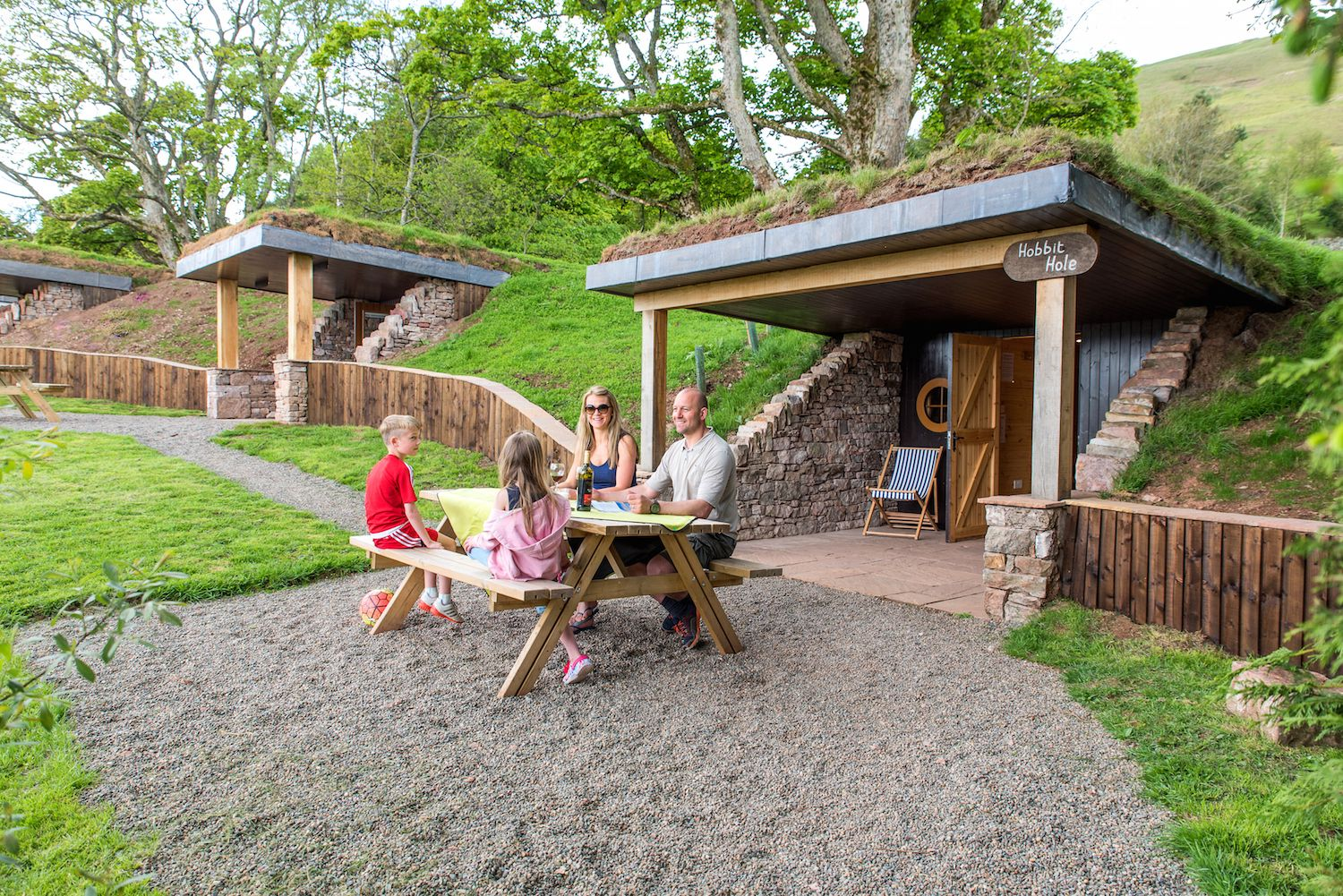 Family glamping in the hobbit holes at The Quiet Site, an eco-friendly campsite near Ullswater in Cumbria