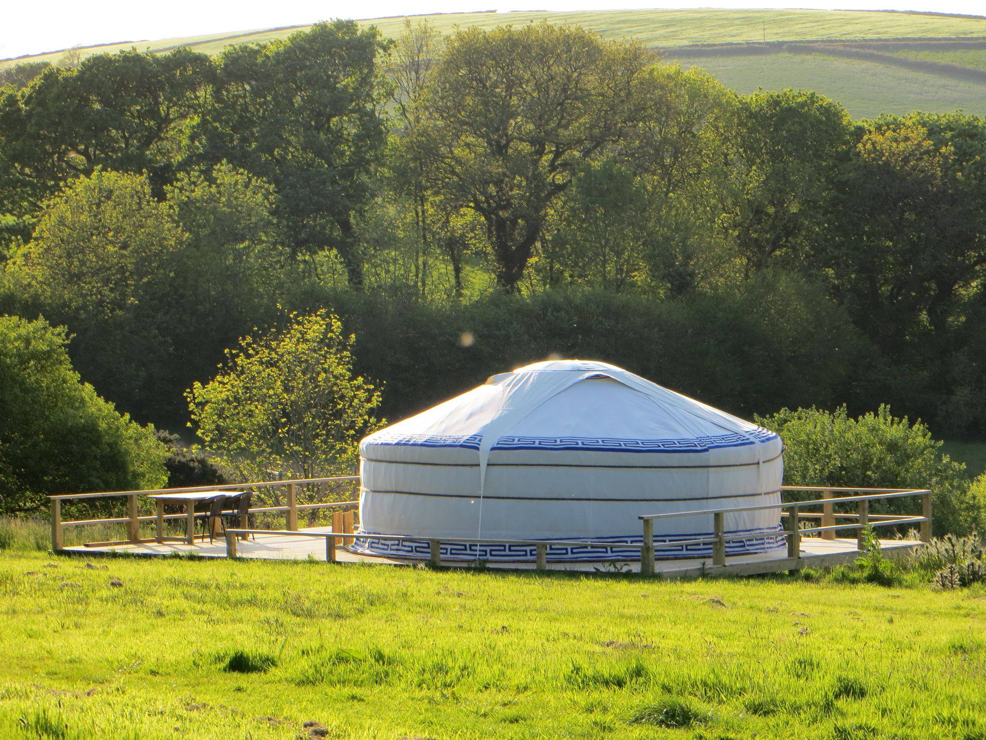 A pair of fully furnished, family-sized, glamping yurts on a working farm in Looe, Cornwall.