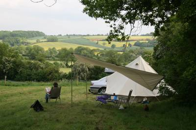 The 100 acres of garden and fields surrounding Wing Hall make for a near perfect camping spot.