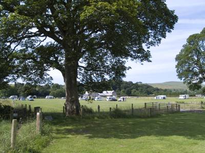 Pitch next to the meandering River Tees, amidst buttercup meadows and the remote, unspoilt surroundings of the Pennines.