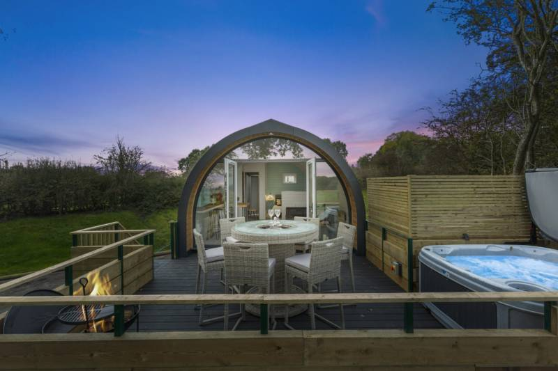 Campfire going and hot tub at the ready at Park Hall Pods.