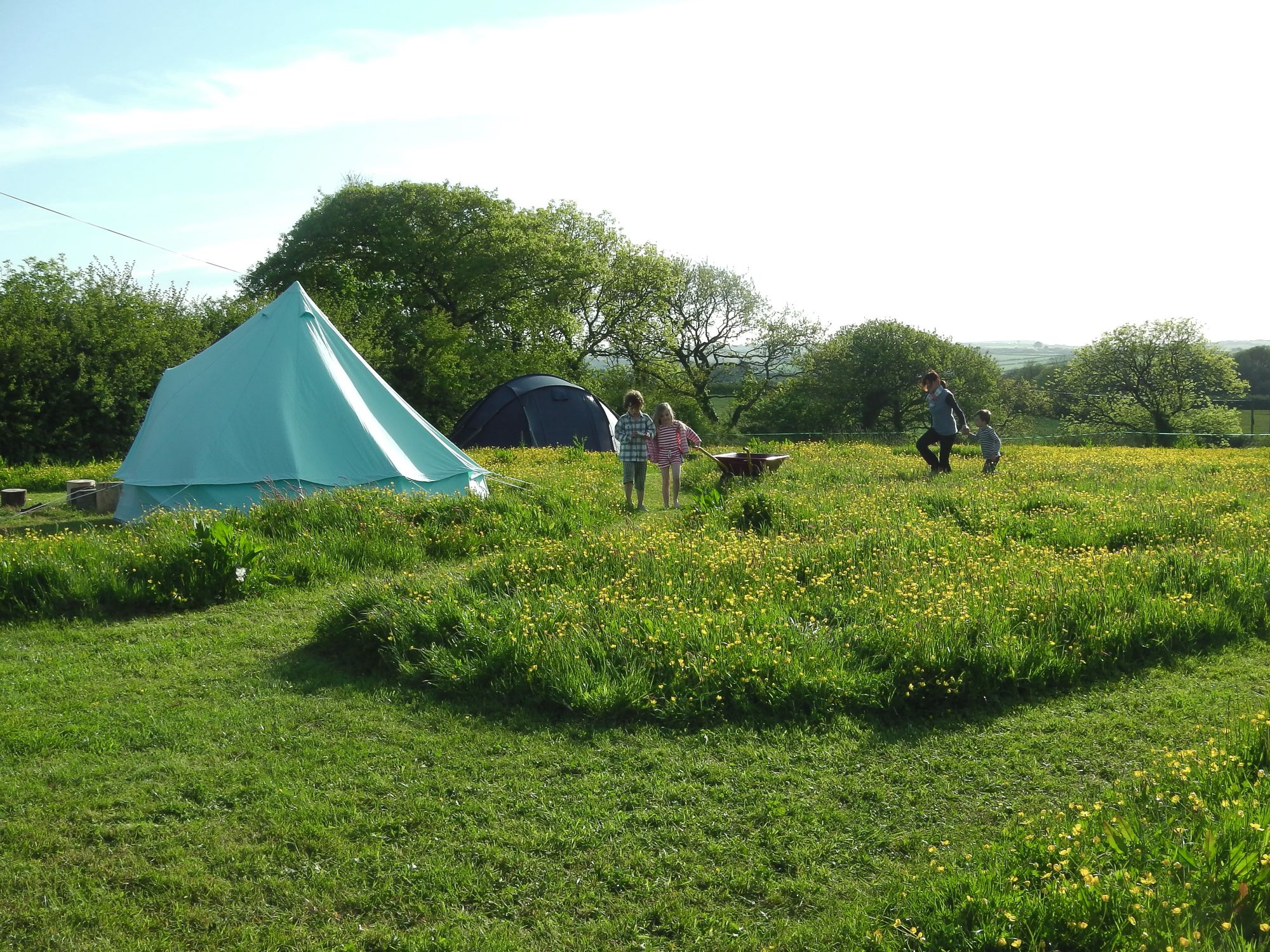 Small-scale camping and glamping on a 33-acre Cornish farm with separate meadows ensuring space, peace and privacy.