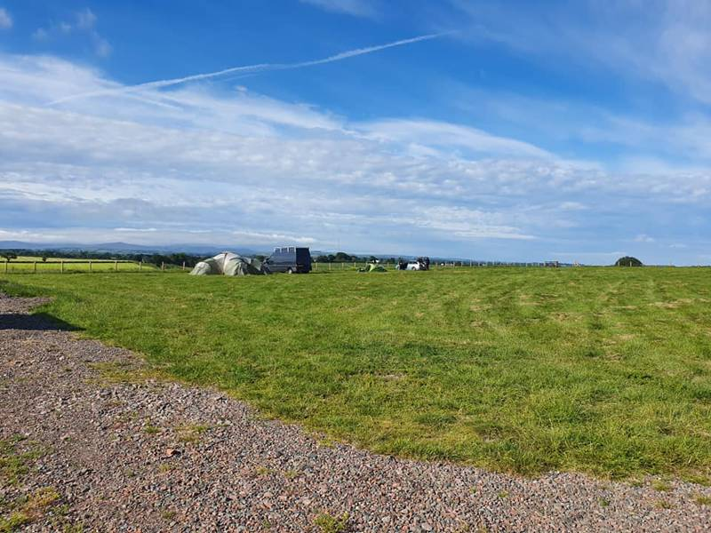 Camping at Cardewlees has plenty of open space and views of the Lake District to the south.